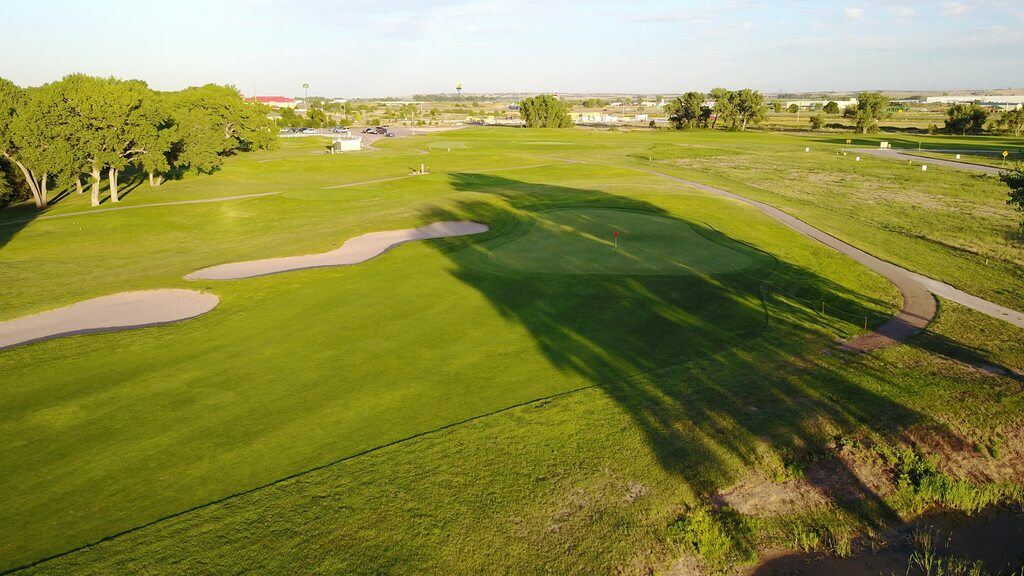 Trees' shadows are cast onto Iron Eagle Golf Course