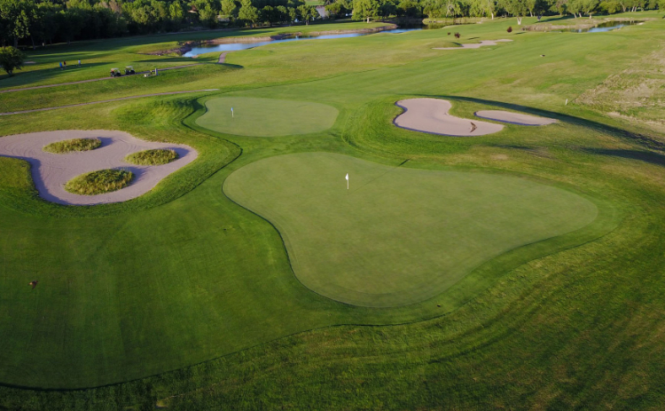 View of the practice area at Iron Eagle Golf Course